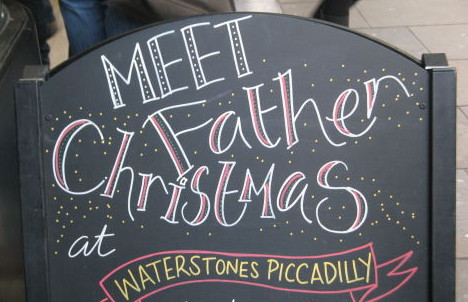 A sign reading 'Meet Father Christmas at Waterstones Piccadilly'