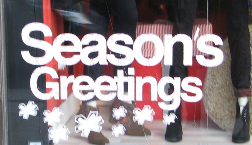 Text in a shopwindow saying 'Season's Greetings'