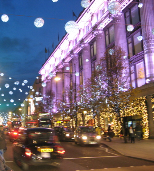 A London Street with Christmas decorations and lights in the evening